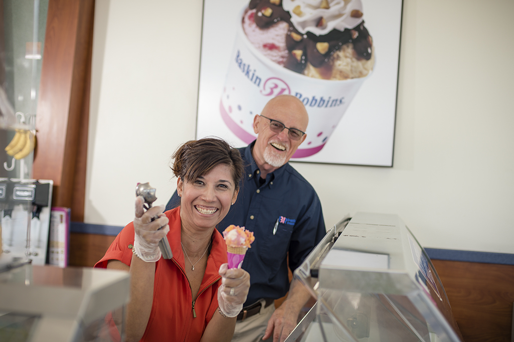 Photo of Community First Bank Relationship Manager Miriam Coffman holding ice cream cone with small business client.